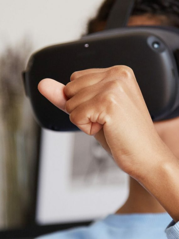Young woman relaxing at home using virtual reality headset for different activities.